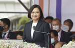 Taiwanese President Tsai Ing-wen delivers a speech during National Day celebrations in front of the Presidential Building in Taipei, Taiwan, Saturday, Oct. 10, 2020. Tsai said Saturday she has hopes for less tensions with China and in the region if Beijing will listen to Taipei's concerns, alter its approach and restart dialogue with the self-ruled island democracy. (AP Photo/Chiang Ying-ying)