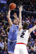 San Diego forward Alex Floresca (15) shoots over Gonzaga forward Drew Timme (2) during the first half of an NCAA college basketball game in Spokane, Wash., Thursday, Feb. 27, 2020. (AP Photo/Young Kwak)