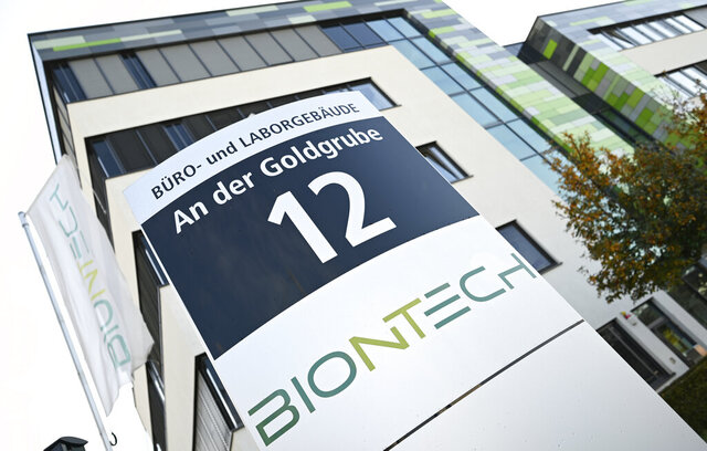 In this Monday, Nov. 9, 2020 photo, the company sign of BioNtech stands in front of the companies headquarters in Mainz, Germany. Pfizer and BioNTech say they've won permission Wednesday, Dec. 2, 2020, for emergency use of their COVID-19 vaccine in Britain, the world's first coronavirus shot that's backed by rigorous science -- and a major step toward eventually ending the pandemic. (Arne Dedert/dpa via AP)