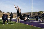 UW Whitewater lineman Quinn Meinerz jumps at the school's pro football day Tuesday, March 9, 2021, in Whitewater, Wisc. The only FCS teams hosting pro days this year were Central Arkansas, North Dakota State and South Dakota State. Division III Wisconsin-Whitewater held one only because its Senior Bowl revelation, offensive lineman Quinn Meinerz, warranted another look after his team did not play in the fall. (AP Photo/Morry Gash)