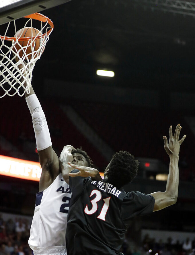 San Diego State's Nathan Mensah defends as Utah State's Neemias Queta shoots during the first half of an NCAA college basketball game in the Mountain West Conference men's tournament championship Saturday, March 16, 2019, in Las Vegas. (AP Photo/Isaac Brekken)