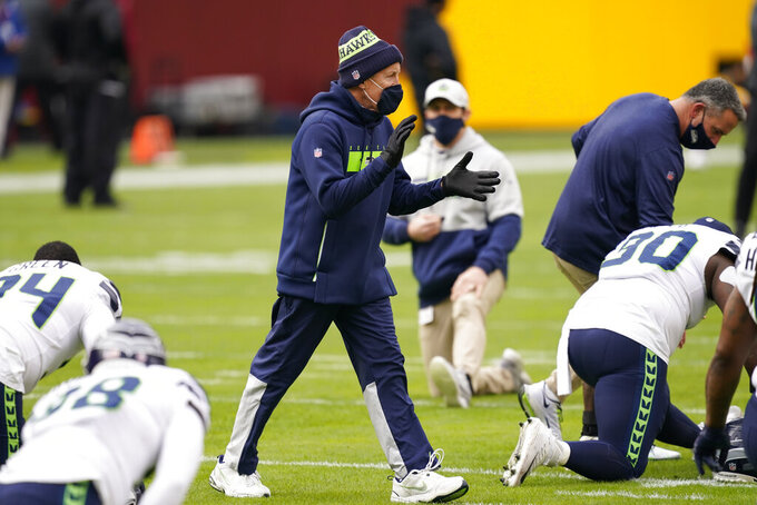 Seattle Seahawks head coach Pete Carroll gestures while on the field before the start of an NFL football game against the Washington Football Team, Sunday, Dec. 20, 2020, in Landover, Md. (AP Photo/Andrew Harnik)