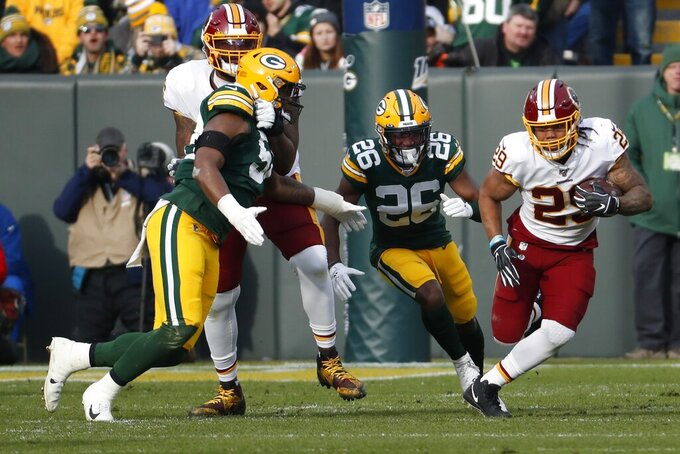 Washington Redskins' Derrius Guice runs during the first half of an NFL football game against the Green Bay Packers Sunday, Dec. 8, 2019, in Green Bay, Wis. (AP Photo/Matt Ludtke)