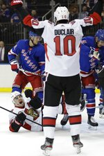 Ottawa Senators' Jean-Gabriel Pageau, bottom left, celebrates with teammate Anthony Duclair (10) after scoring a goal during the first period of an NHL hockey game against the New York Rangers, Monday, Nov. 4, 2019, in New York. (AP Photo/Frank Franklin II)