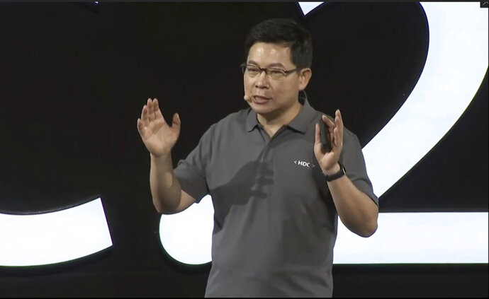 In this image from video released by Huawei, Richard Yu, CEO of Huawei Consumer Business Group, speaks during a news conference in Dongguan, China, Friday, Aug. 9, 2019. Huawei unveiled a smartphone operating system that it said can replace Google's Android, adding to the Chinese tech giant's efforts to insulate itself against U.S. sanctions. The announcement of HarmonyOS highlights the growing ability of Huawei, the No. 2 global smartphone brand and biggest maker of network gear for phone carriers, to create technology and reduce its reliance on American vendors. (Huawei via AP)