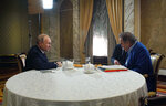 This photo taken on Wednesday, June 19, 2019, and distributed by Kremlin Press Service shows Russian President Vladimir Putin, left, during an interview with American movie director Oliver Stone for his Revealing Ukraine documentary in the Kremlin in Moscow, Russia. (Alexei Druzhinin, Sputnik, Kremlin Pool Photo via AP)