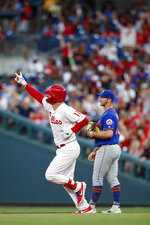 Philadelphia Phillies' Rhys Hoskins, left, reacts as he runs the bases past New York Mets first baseman Pete Alonso after hitting a home run off starting pitcher Walker Lockett during the fourth inning of a baseball game Tuesday, June 25, 2019, in Philadelphia. (AP Photo/Matt Slocum)