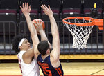 Rutgers guard Ron Harper Jr. (24) attempts to shoot as Illinois forward Giorgi Bezhanishvili (15) defends during the second half of an NCAA college basketball game Sunday, Dec. 20, 2020, in Piscataway, N.J. (AP Photo/Bill Kostroun)