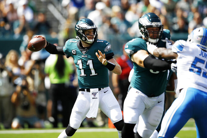Philadelphia Eagles' Carson Wentz throws a pass during the first half of an NFL football game against the Detroit Lions, Sunday, Sept. 22, 2019, in Philadelphia. (AP Photo/Matt Rourke)
