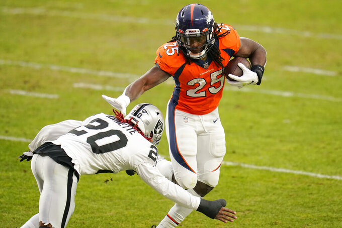 Denver Broncos running back Melvin Gordon (25) runs against Las Vegas Raiders cornerback Damon Arnette (20) during the first half of an NFL football game, Sunday, Jan. 3, 2021, in Denver. (AP Photo/Jack Dempsey)