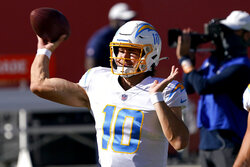 Los Angeles Chargers quarterback Justin Herbert (10) warms up prior to an NFL football game against the Denver Broncos, Sunday, Nov. 1, 2020, in Denver. (AP Photo/David Zalubowski)