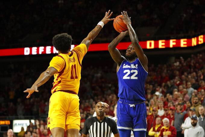 Seton Hall guard Myles Cale, right, shoots over Iowa State guard Prentiss Nixon, left, during the first half of an NCAA college basketball game, Sunday, Dec. 8, 2019, in Ames, Iowa. (AP Photo/Matthew Putney)