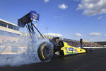 In this photo provided by the NHRA, Brittany Force takes part in Top Fuel qualifying at the Mopar Express Lane NHRA Nationals drag races Saturday, Sept. 11, 2021, at Maple Grove Raceway in Mohnton, Pa. (Marc Gewertz/NHRA via AP)
