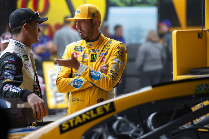 Kevin Harvick No. 4, left, and Kyle Busch No. 18 talk before the start of the Monster Energy NASCAR Cup Series practice, Saturday, May 4, 2019, at Dover International Speedway in Dover, Del. (AP Photo/Jason Minto)