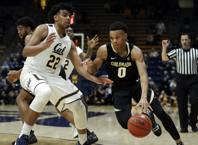 Colorado's Shane Gatling, right, drives the ball as California's Andre Kelly (22) defends during the second half of an NCAA college basketball game Thursday, Jan. 24, 2019, in Berkeley, Calif. (AP Photo/Ben Margot)