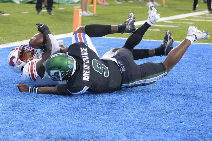 SMU wide receiver Rashee Rice (11) scores against Tulane cornerback Jaylon Monroe (9) during an NCAA college football game in New Orleans, Friday, Oct. 16, 2020. (AP Photo/Matthew Hinton)
