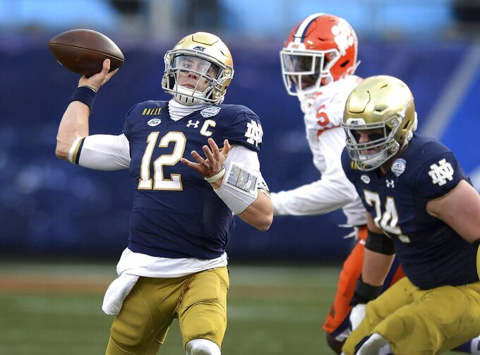 Notre Dame quarterback Ian Book throws a pass against Clemson during the Atlantic Coast Conference championship NCAA college football game, Saturday, Dec. 19, 2020, in Charlotte, N.C. (Jeff Siner/The News & Observer via AP)