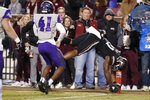 Mississippi State running back Nick Gibson (21) dives into the end zone past Abilene Christian cornerback Alex Lofton (41) for an 11-yard touchdown pass reception during the first half of an NCAA college football game, Saturday, Nov. 23, 2019, in Starkville, Miss. (AP Photo/Rogelio V. Solis)