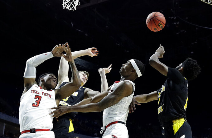 Texas Tech's Deshawn Corprew (3) and Tariq Owens, second from right, along with Northern Kentucky's Chris Vogt, second from left, and Trevon Faulkner, right, chase a rebound during the first half of a first round men's college basketball game in the NCAA Tournament Friday, March 22, 2019, in Tulsa, Okla. (AP Photo/Charlie Riedel)