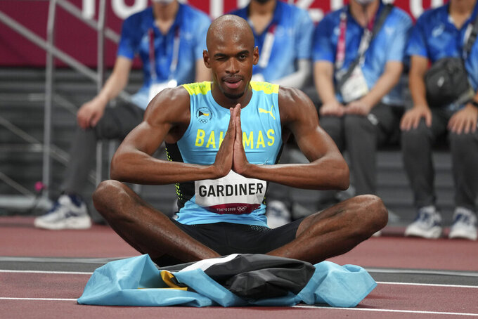 Steven Gardiner, of the Bahamas, reacts after winning the final of the men's 400-meters at the 2020 Summer Olympics, Thursday, Aug. 5, 2021, in Tokyo. (AP Photo/Matthias Schrader)