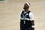 Milwaukee Bucks center Bobby Portis (9) reacts during the first half of Game 6 of basketball's NBA Finals against the Phoenix Suns Tuesday, July 20, 2021, in Milwaukee. (AP Photo/Aaron Gash)