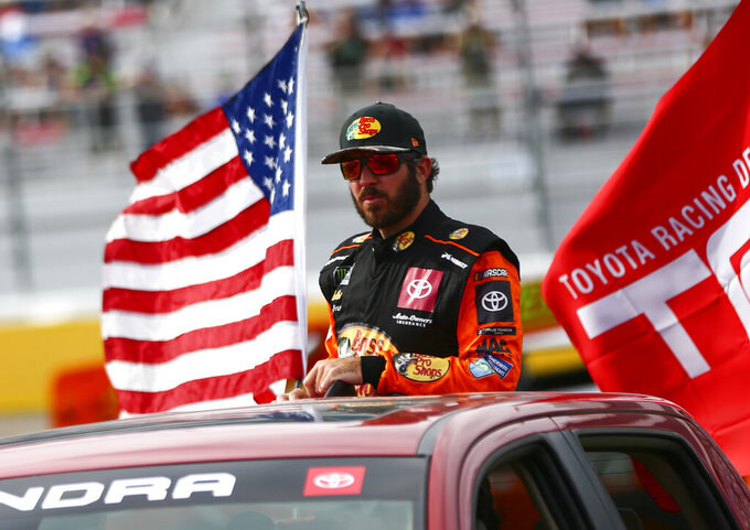 Martin Truex Jr. heads to his car before a NASCAR Cup Series auto race at the Las Vegas Motor Speedway on Sunday, Sept. 15, 2019. (AP Photo/Chase Stevens)