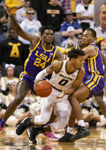 Missouri's Torrence Watson, center, dribbles around LSU's Emmitt Williams, left, and Ja'vonte Smart during the first half of an NCAA college basketball game Saturday, Jan. 26, 2019, in Columbia, Mo. (AP Photo/L.G. Patterson)
