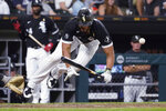 Chicago White Sox's Jose Abreu is hit by a pitch from Pittsburgh Pirates' Anthony Banda during the sixth inning of a baseball game Wednesday, Sept. 1, 2021, in Chicago. (AP Photo/Charles Rex Arbogast)