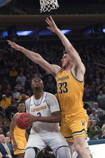 Wichita State center Asbjorn Midtgaard (33) guards Lipscomb center Ahsan Asadullah (2) during the first half of a semifinal college basketball game in the National Invitational Tournament, Tuesday, April 2, 2019, at Madison Square Garden in New York. (AP Photo/Mary Altaffer)