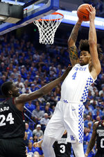 Kentucky's Nick Richards (4) pulls down a rebound near Mississippi State's Abdul Ado (24) during the first half of an NCAA college basketball game in Lexington, Ky., Tuesday, Feb. 4, 2020. (AP Photo/James Crisp)