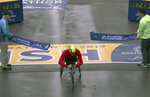 Daniel Romanchuk, of Urbana, Ill., breaks the tape to win the men's handcycle division of the 123rd Boston Marathon on Monday, April 15, 2019, in Boston. (AP Photo/Charles Krupa)