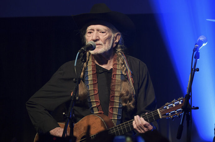 "FILE - In this Feb. 6, 2019 file photo, Willie Nelson performs at the Producers & Engineers Wing 12th Annual GRAMMY Week Celebration at the Village Studio in Los Angeles.  Nelson has canceled his tour because of a ""breathing problem."" The 86-year-old singer apologized on Twitter late Wednesday, Aug. 7, writing ""I need to have my doctor check out."" Nelson had just finished performing with Alison Krauss in Toledo, Ohio, and he was next scheduled to appear Friday in Grand Rapids, Mich. He wrote ""I'll be back.""(Photo by Richard Shotwell/Invision/AP, File)"