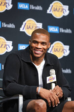 Los Angeles Lakers guard Russell Westbrook smiles during an introductory NBA basketball news conference in Los Angeles, Tuesday, Aug. 10, 2021. (AP Photo/Kyusung Gong)