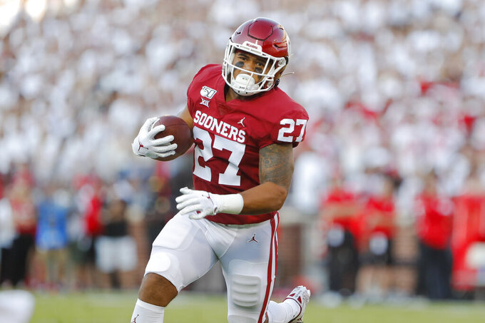 Oklahoma fullback Jeremiah Hall (27) runs in for a touchdown against Houston during the first half of an NCAA college football game in Norman, Okla., Sunday, Sept. 1, 2019. (AP Photo/Alonzo Adams)