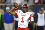 Utah quarterback Tyler Huntley throws a pass against Utah during the first half of an NCAA college football game Saturday, Nov. 23, 2019, in Tucson, Ariz. (AP Photo/Rick Scuteri)