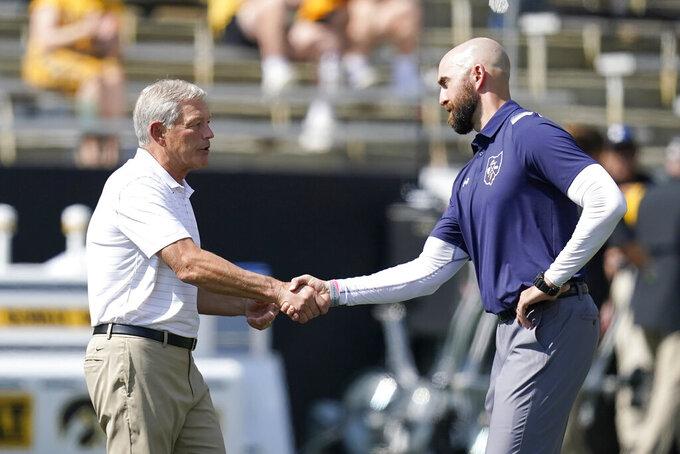 Iowa head coach Kirk Ferentz, left, greets Kent State head coach Sean Lewis before an NCAA college football game, Saturday, Sept. 18, 2021, in Iowa City, Iowa. (AP Photo/Charlie Neibergall)