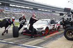 Brad Keselowski (2) pits during a caution at a NASCAR Cup Series auto race at Texas Motor Speedway in Fort Worth, Texas, Sunday, Oct. 25, 2020. (AP Photo/Richard W. Rodriguez)