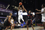 Hofstra guard Desure Buie (4) passes the ball as Northeastern guard Tyson Walker (2) defends during the second half of an NCAA college basketball game for the championship of the Colonial Athletic Association men's tournament Tuesday, March 10, 2020, in Washington. Hofstra won 70-61. (AP Photo/Nick Wass)