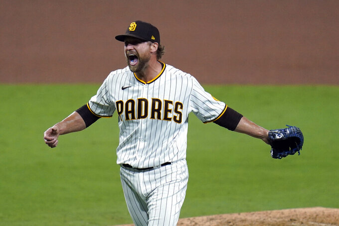San Diego Padres relief pitcher Trevor Rosenthal celebrates after the Padres defeated the St. Louis Cardinals 4-0 in Game 3 of a National League wild-card baseball series Friday, Oct. 2, 2020, in San Diego. The Padres advanced to the NL Division Series. (AP Photo/Gregory Bull)