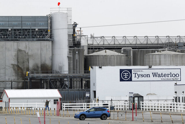 FILE - In this May 1, 2020, file photo, a worker leaves the Tyson Foods plant in Waterloo, Iowa. An employee at the Waterloo plant died Monday, May 25, 2020, after battling the coronavirus during a six-week hospitalization that was chronicled and widely followed online. (AP Photo/Charlie Neibergall, File)