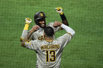 San Diego Padres' Jurickson Profar, top, celebrates his two-run home run with Manny Machado during the fourth inning of a baseball game against the Los Angeles Angels, Wednesday, Sept. 2, 2020, in Anaheim, Calif. (AP Photo/Jae C. Hong)