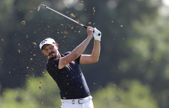 Mike Lorenzo-Vera of France plays a shot on the 3rd hole during the second round of the DP World Tour Championship golf tournament in Dubai, United Arab Emirates, Friday, Nov. 22, 2019. (AP Photo/Kamran Jebreili)