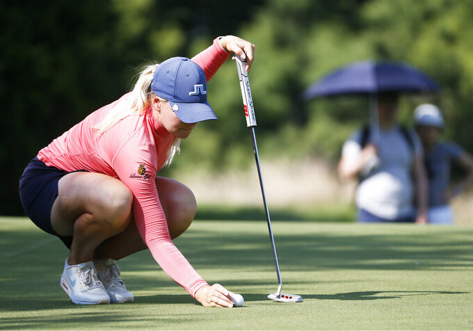 Matilda Castren, of Finland, lines up her putt on the 12th hole during the final round of the LPGA Volunteers of America Classic golf tournament in The Colony, Texas, Sunday, July 4, 2021. (AP Photo/Ray Carlin)