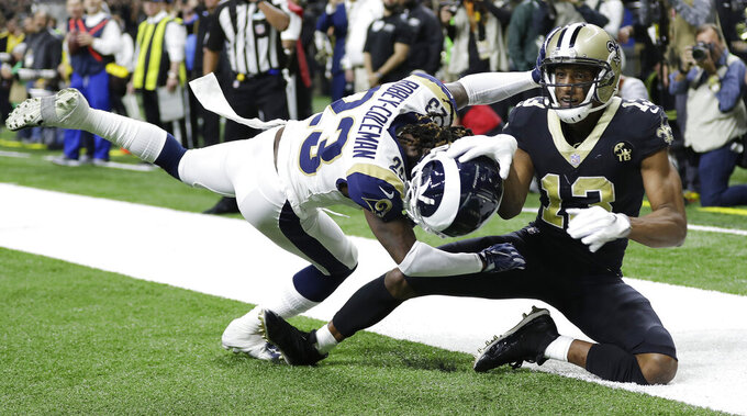 Los Angeles Rams' Nickell Robey-Coleman breaks up a pass intended for New Orleans Saints' Michael Thomas during the second half of the NFL football NFC championship game, Sunday, Jan. 20, 2019, in New Orleans. (AP Photo/David J. Phillip)