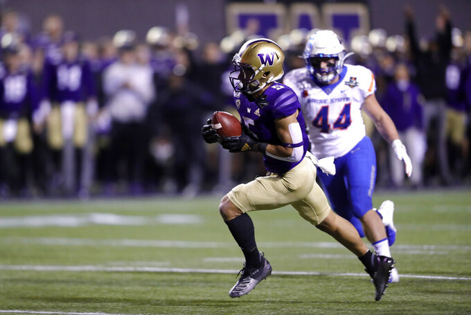 Washington wide receiver Andre Baccellia (5) is pursued by Boise State linebacker Riley Whimpey (44) during a touchdown run in the first half of the Las Vegas Bowl NCAA college football game, Saturday, Dec. 21, 2019, in Las Vegas. (AP Photo/Steve Marcus)
