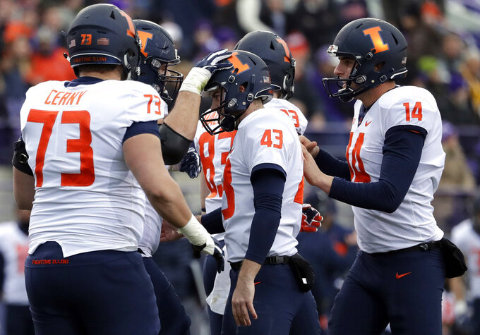 Illinois kicker Chase McLaughlin (43) is congratulated by teammates after kicking a field goal against Northwestern during the first half of an NCAA college football game in Evanston, Ill., Saturday, Nov. 24, 2018. (AP Photo/Nam Y. Huh)