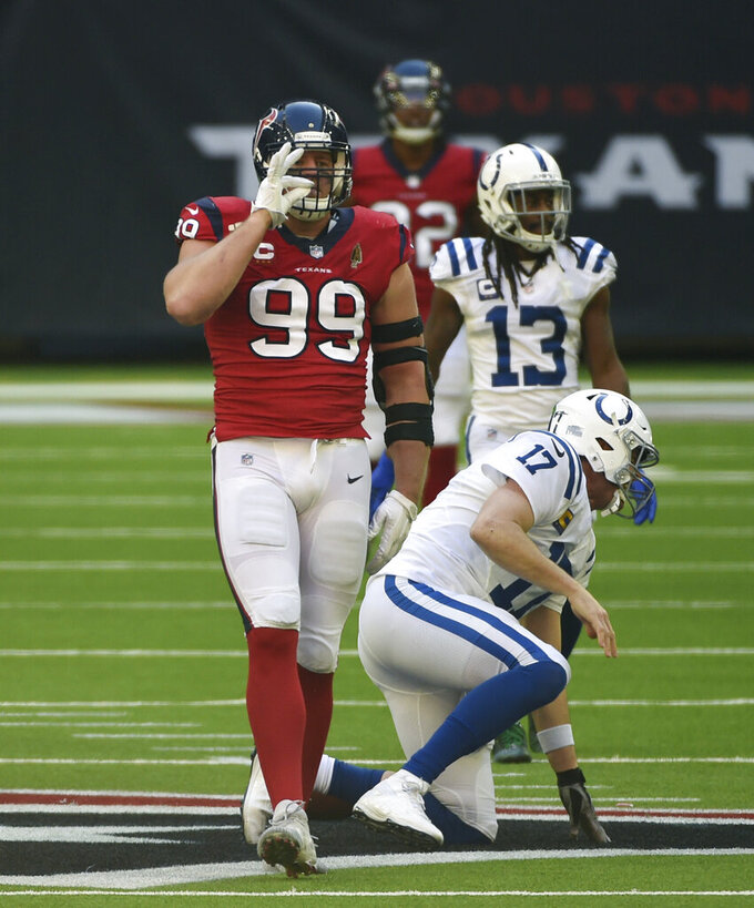 Houston Texans defensive end J.J. Watt (99) celebrates after he sacked Indianapolis Colts quarterback Philip Rivers (17) during the second half of an NFL football game Sunday, Dec. 6, 2020, in Houston. (AP Photo/Eric Christian Smith)
