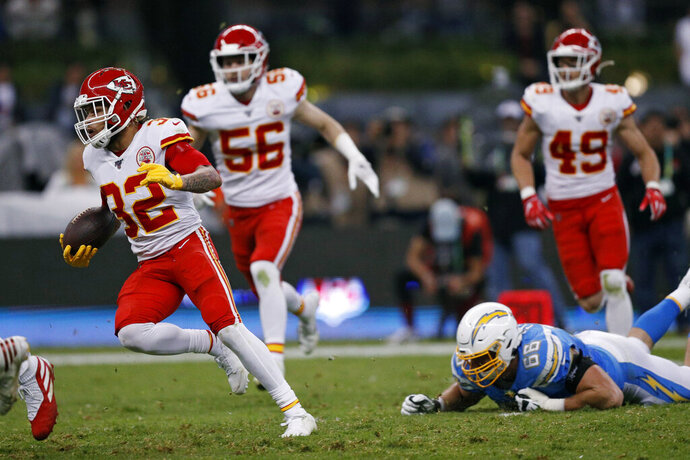 Kansas City Chiefs strong safety Tyrann Mathieu, right, runs after an interception during the first half of an NFL football game against the Los Angeles Chargers, Monday, Nov. 18, 2019, in Mexico City. (AP Photo/Rebecca Blackwell)