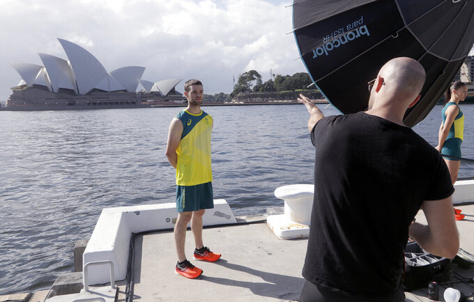 Tom O'Halloran poses for a photographer after Olympic hopefuls were presented their green and gold competition kits in Sydney Wednesday, March 31, 2021, during the unveiling of the uniforms the Australian team will wear during the Tokyo Olympic games. (AP Photo/Rick Rycroft)