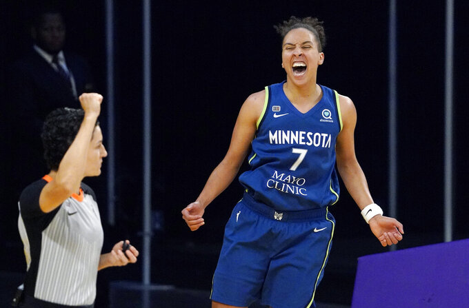 Minnesota Lynx guard Layshia Clarendon, right, celebrates after scoring and drawing a foul during the second half of a WNBA basketball game against the Los Angeles Sparks Sunday, July 11, 2021, in Los Angeles. The Lynx won 86-61. (AP Photo/Mark J. Terrill)